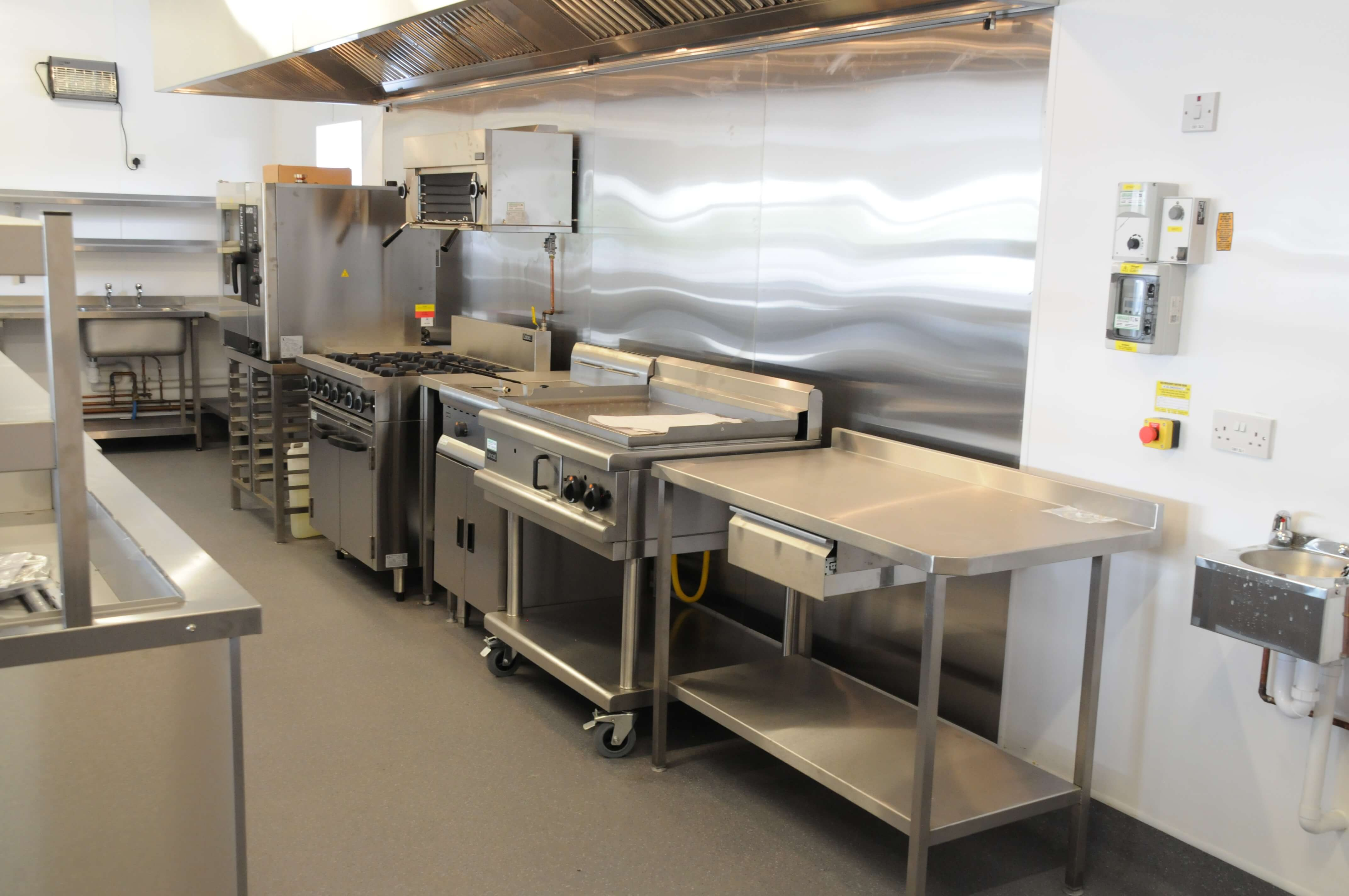 we also supplied and fitted a hygienic pvc wall cladding system which created a bright and clean environment within the kitchen and reduced cleaning time